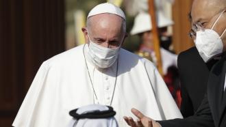 Pope Francis is welcomed by Iraqi President Barham Salih.