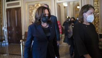 Vice President Kamala Harris arrives to break the tie on a procedural vote as the Senate works on the COVID relief package