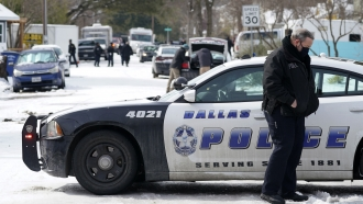 A Dallas police officer patrols an intersection