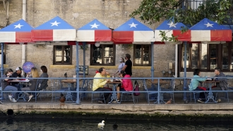 Diners eat at a restaurant on the River Walk in San Antonio, Texas