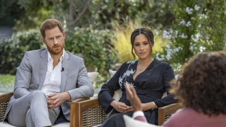 Prince Harry and Meghan, the Duchess of Sussex, speak with Oprah Winfrey