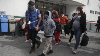 A migrant family crosses the border into El Paso, Texas, in Ciudad Juarez, Mexico.