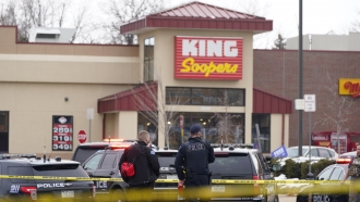 Police stand outside a King Soopers grocery store where a shooting took place in Boulder, Colorado