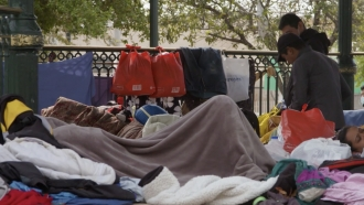 Migrants wait in a Reynosa, Mexico park