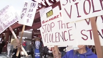 Signs calling to stop violence