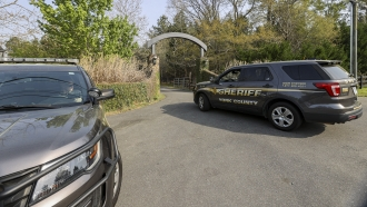 A York County sheriff vehicle drives onto the property where multiple people, including a prominent doctor, were fatally shot