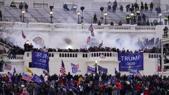 Rioters storm the Capitol in what became a deadly riot.