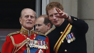 Britain's Prince Harry (right) talks to his grandfather, Prince Philip (left)