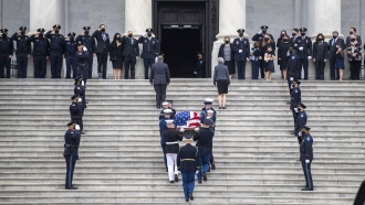 "The flag-draped casket of U.S. Capitol Police officer William ""Billy"" Evans, arrives to lie in honor at the U.S. Capitol."