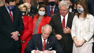 South Carolina Gov. Henry McMaster signs into law a bill banning almost all abortions