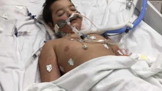 Child lays in hospital bed