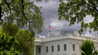 The American flag files at half-staff above the White House