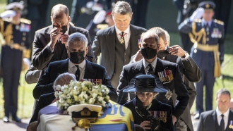 Pall Bearers carry the coffin of the Duke of Edinburgh into St George's Chapel for his funeral.