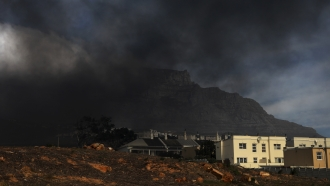 Clouds of dark smoke hang above the city of Cape Town, South Africa.