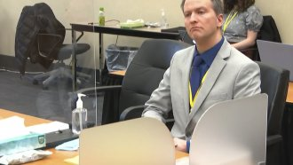 Former Minneapolis police Officer Derek Chauvin listens as his defense attorney Eric Nelson gives closing arguments