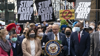 Senate Majority Leader Chuck Schumer speaks at a news conference to discuss an Asian-American hate crime bill.