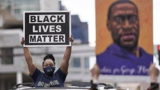 Woman holding Black Lives Matter sign
