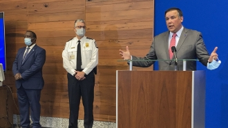 Columbus Mayor Andrew Ginther, right, during a news conference about the fatal police shooting of 16-year-old Ma'Khia Bryant
