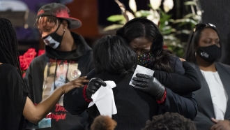 Mourners gather during a wake for Daunte Wright