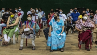 People wait to receive the COVAXIN vaccine for COVID-19 in India