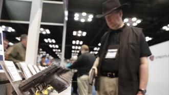 A gun enthusiast at a National Rifle Association Annual Meeting