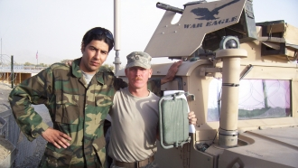 Afghan interpreter Janis Shinwari (left) and a U.S. solider in Afghanistan