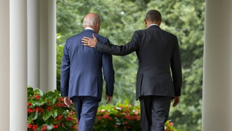 President Barack Obama walks with Vice President Joe Biden back to the Oval Office of the White House.