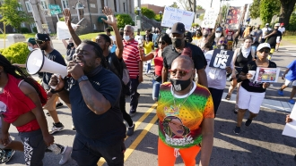 Protesters march along the streets to protest the shooting of Andrew Brown Jr.