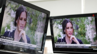ustralian television news in Sydney, Monday, March 8, 2021, reports on an interview of The Duke and Duchess of Sussex