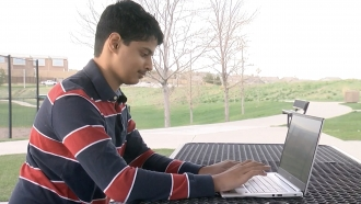 Boy works on a computer