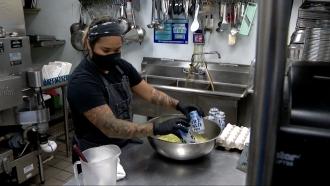 Woman makes a dish.