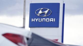 Hyundai company logo at a car dealership.