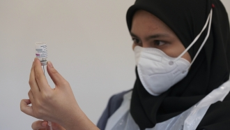 A health worker prepares to administer the AstraZeneca COVID-19 vaccine at a vaccination center in Kuala Lumpur, Malaysia.