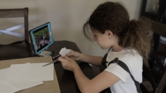 Student works with tutor virtually