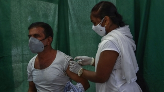 A health worker administers a vaccine for COVID-19 in Hyderabad, India