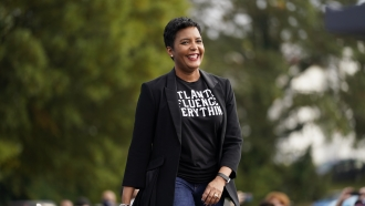 Atlanta Mayor Keisha Lance Bottoms arrives to speak during a drive-in rally.