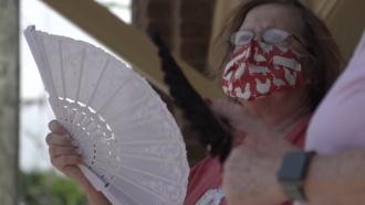 Woman fanning to avoid heat