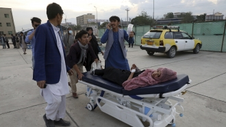 Girl is brought to a hospital after a bomb explosion near a school in west Kabul, Afghanistan, Saturday.