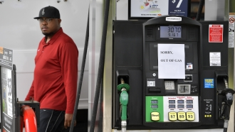 "Gas pump with ""out of gas"" sign"