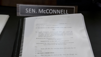 A book of amendments awaits Senate Minority Leader Mitch McConnell of Ky., at a Senate Rules Committee hearing at the Capitol