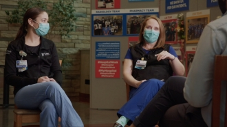 Nurse talks in a group