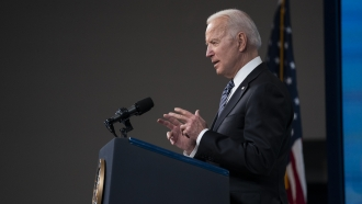 President Joe Biden delivers remarks in the South Court Auditorium at the White House.