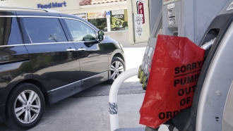 A customer drives from a Chevron station after it ran out of gasoline, Wednesday, May 12, 2021, in Miami.