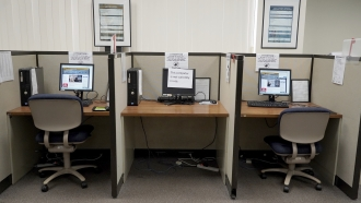 Work stations with social distancing measures in place