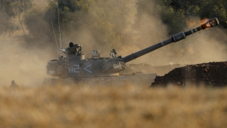 An Israeli artillery unit fires toward targets in Gaza Strip