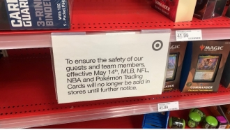 Target sign telling customers they aren't selling trading cards in stores