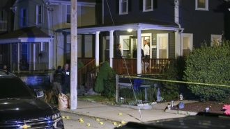 Providence Police investigate a shooting on Carolina Avenue, late Thursday, May 13, 2021, in Providence, R.I.