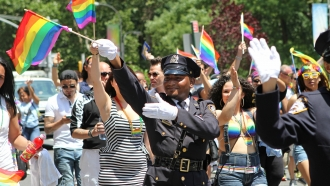 NYPD police officers march along Fifth Avenue during the gay pride parade in New York