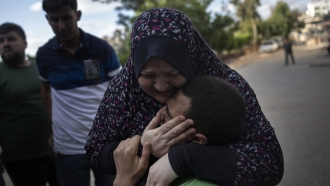 Relatives react to death of a man killed by an Israeli airstrike in Gaza City