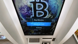 The Bitcoin logo appears on a cryptocurrency ATM.